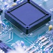 Semiconductor components on a blue background — Stok fotoğraf