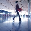 Woman hurrying in airport — Stock Photo