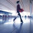 Stock Photo: Woman hurrying in airport