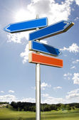 Roadsign with empty direction arrows isolated on sky — Stock Photo