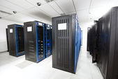 A server room with black servers — Stock Photo