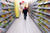 A woman shopping with zooming blur — Stock Photo
