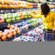 Young womshopping in supermarket — Stock Photo #24434123