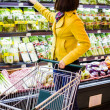Young womshopping in supermarket — Stock Photo #24488957