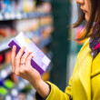 Young woman shopping in the supermarket — Stock Photo #24506009