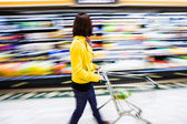 Shopping at the supermarket,motion blur — Stock Photo