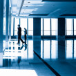 Image of silhouettes at morden office building — Stock Photo