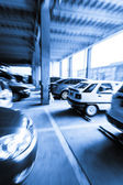 Parking garage, interior with a few parked cars.Motion blur — Stock Photo