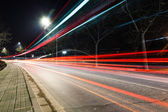 Light traces on traffic junctions at night — Stock Photo
