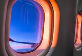 Sky as seen through window of an aircraft — Stock Photo