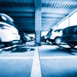 Parking garage, interior with a few parked cars,Motion blur — Stock Photo