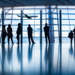 Travelers silhouettes at airport,Beijing — Stock Photo