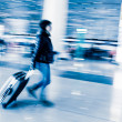 Passenger in the Beijing airport,motion blur — Stock Photo