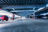 Parking garage, interior with a few parked cars. — Stock Photo