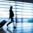 Traveler silhouettes at airport,motion blur,Beijing — Stock fotografie