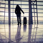 Traveler silhouettes at airport,Beijing — Stock Photo
