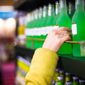 Closeup selection of merchandise in the supermarket — Stock Photo