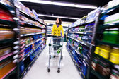 Young woman shopping in the supermarket — Stok fotoğraf