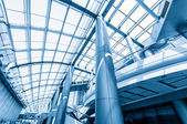 Blue glass ceiling in office centre — Stockfoto
