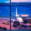 Parked aircraft on beijing airport through the gate window — Stock Photo