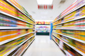 Empty supermarket aisle,motion blur — Foto Stock