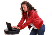 A young girl with a laptop — Stock Photo