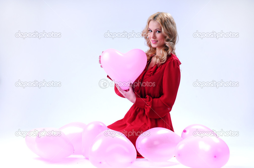 Woman with red heart balloon on a white background — Stock Photo #17859447