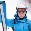 Stock Photo: Girl in ski suit with skis