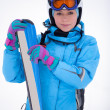 Girl in ski suit with skis — Stock fotografie