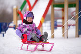 Child on a sledge — Stock Photo