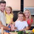 Happy family cooking together in the kitchen — Stock Photo #18804367