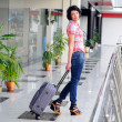 Pretty young female passenger at the airport — Stock Photo #21612965