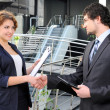 Stock Photo: Confident business partners in office building