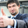Portrait of a smiling businessman giving thumbs up — Stock Photo
