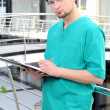 Medical doctor man in the office - Stockfoto
