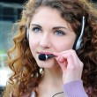 Portrait of happy smiling cheerful support phone operator in headset at office — Stock Photo