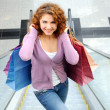 Beautiful shopping woman at a drawn mall — Stock Photo
