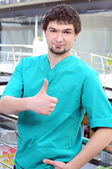 Medical doctor man in the office shows thumb up — 图库照片