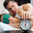 Guy turning off alarm clock — Stock Photo