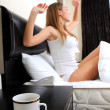 Portrait of beautiful woman with cup on bed at bedroom — Stock Photo