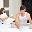 Poor woman, because her husband is in bed, relationship problems — Foto de Stock