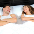 A couple lying in bed - Stockfoto