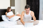 Poor woman, because her husband is in bed, relationship problems — Stock Photo