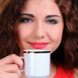 Royalty-Free Stock Photo: Portrait of beautiful woman drinking coffee