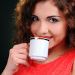 Portrait of beautiful woman drinking coffee — Stock Photo