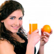 Young beautiful woman drinking orange juice isolated on a white background — Stock Photo