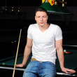 Portrait of a young man playing snooker — Stock Photo