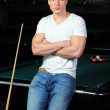 Portrait of a young man playing snooker — Stock Photo #22488541