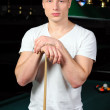 Portrait of a young man playing snooker — Stock Photo #22488565