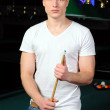Portrait of a young man playing snooker — Stock Photo #22488571